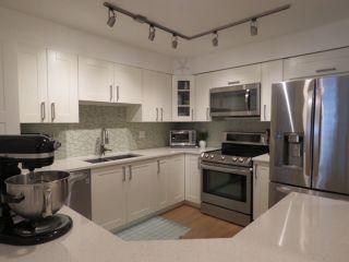 "Photo 1: 114 15555 16 Avenue in Surrey: Sunnyside Park Surrey Condo for sale in ""SANDRINGHAM"" (South Surrey White Rock)  : MLS®# R2380093"
