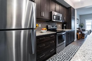 Photo 8: 374 Nolancrest Heights NW in Calgary: Nolan Hill Row/Townhouse for sale : MLS®# A1145723