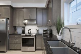 Photo 17: 131 SPRINGBLUFF Boulevard SW in Calgary: Springbank Hill Detached for sale : MLS®# A1066910