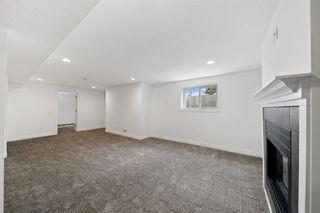 Photo 26: 316 Queen Alexandra Road SE in Calgary: Queensland Detached for sale : MLS®# A1142410