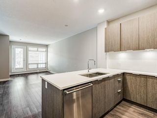 Photo 4: 216 823 5 Avenue NW in Calgary: Sunnyside Apartment for sale : MLS®# A1127836