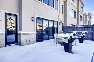 Photo 2: 10 Valour Circle SW in Calgary: Currie Barracks Row/Townhouse for sale : MLS®# A1069872