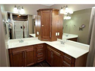 Photo 11: 112 PANATELLA Manor NW in Calgary: Panorama Hills House for sale : MLS®# C4107196