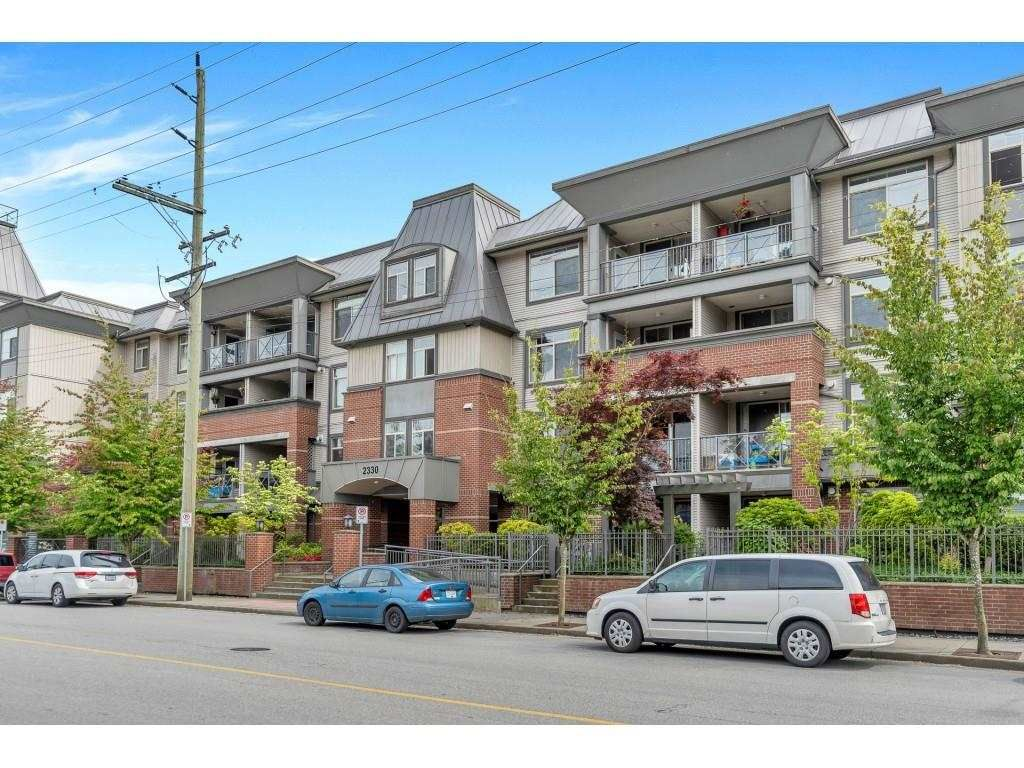 """Main Photo: 404 2330 WILSON Avenue in Port Coquitlam: Central Pt Coquitlam Condo for sale in """"SHAUGHNESSY WEST"""" : MLS®# R2588872"""