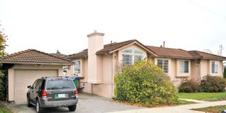 Photo 1: 7456 MARY Avenue in Burnaby: Edmonds BE 1/2 Duplex for sale (Burnaby East)  : MLS®# R2602810