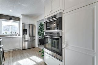 Photo 7: 84 Coach Side Terrace SW in Calgary: Coach Hill Semi Detached for sale : MLS®# A1077504