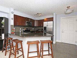 Photo 2: 419 500 Rocky Vista Gardens NW in Calgary: Rocky Ridge Apartment for sale : MLS®# A1127679