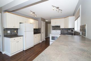 Photo 11: 117 Coverdale Road NE in Calgary: Coventry Hills Detached for sale : MLS®# A1075878