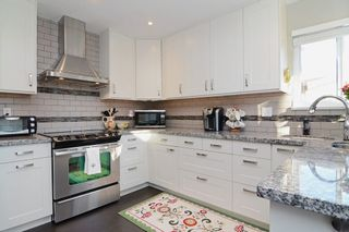 """Photo 7: 1056 LOMBARDY Drive in Port Coquitlam: Lincoln Park PQ House for sale in """"LINCOLN PARK"""" : MLS®# R2126810"""