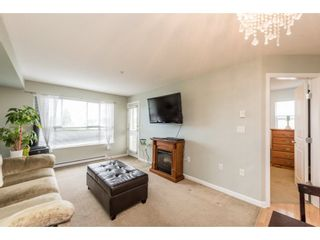"""Photo 4: 313 5465 203 Street in Langley: Langley City Condo for sale in """"STATION 54"""" : MLS®# R2206615"""