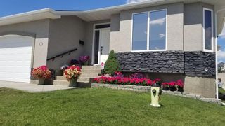 Photo 2: 72 Elysian Crescent SW in Calgary: Springbank Hill Semi Detached for sale : MLS®# A1148526