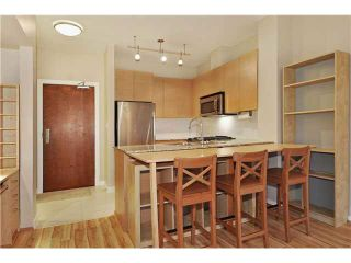 """Photo 4: 408 5775 IRMIN Street in Burnaby: Metrotown Condo for sale in """"MACPHERSON WALK"""" (Burnaby South)  : MLS®# V1097253"""