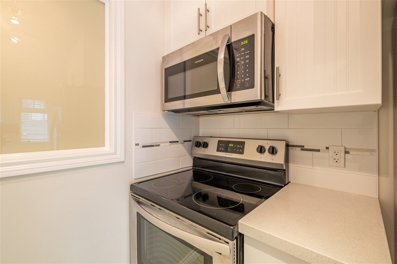 """Photo 10: Photos: 409 5650 201A Street in Langley: Langley City Condo for sale in """"Paddington Station"""" : MLS®# R2566139"""