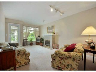"""Photo 2: 408 3625 WINDCREST Drive in North Vancouver: Roche Point Condo for sale in """"WINDSONG III"""" : MLS®# V890113"""
