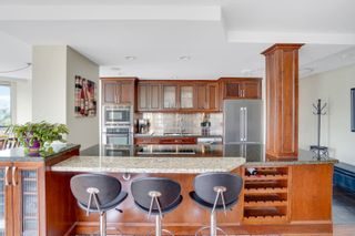"""Photo 7: 311 1450 PENNYFARTHING Drive in Vancouver: False Creek Condo for sale in """"Harbour Cove/False Creek"""" (Vancouver West)  : MLS®# R2618679"""