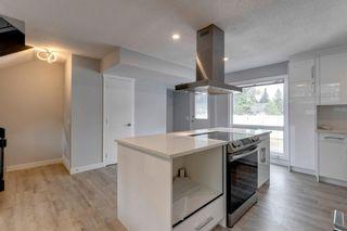 Photo 15: 21 Brae Glen Court in Calgary: Braeside Row/Townhouse for sale : MLS®# A1141079