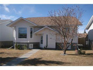 Photo 1: 35 WEST MCDOUGAL Road: Cochrane House for sale : MLS®# C4053037