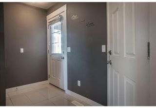 Photo 2: 95 West Coach Manor SW in Calgary: West Springs Row/Townhouse for sale : MLS®# A1114599