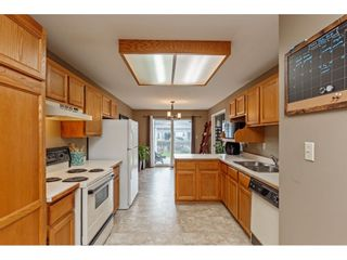 """Photo 12: 103 5641 201 Street in Langley: Langley City Townhouse for sale in """"THE HUNTINGTON"""" : MLS®# R2537246"""