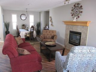 Photo 8: 112 MCDOUGALL Place: Langdon Detached for sale : MLS®# A1023577