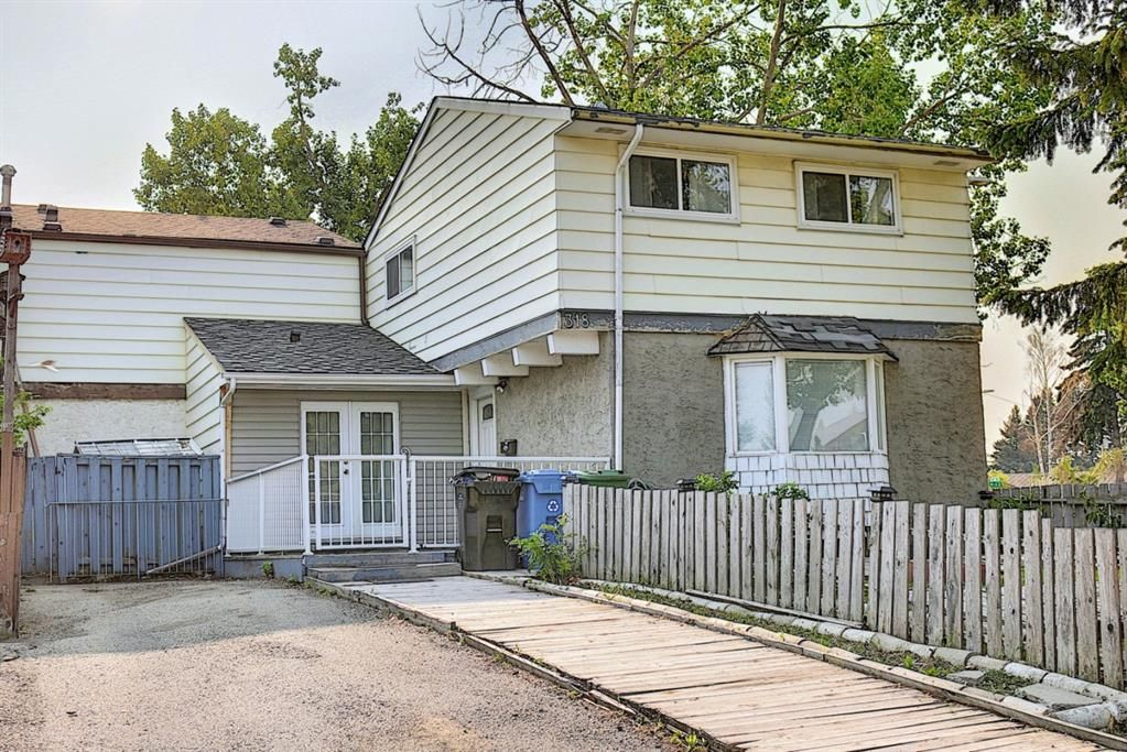 Main Photo: 318 43 Street SE in Calgary: Forest Heights Row/Townhouse for sale : MLS®# A1136243