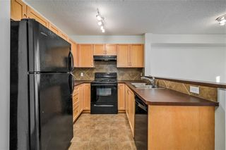 Photo 2: 8108 70 PANAMOUNT Drive NW in Calgary: Panorama Hills Apartment for sale : MLS®# C4299723