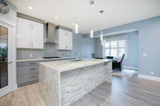 Photo 9: 48 Tremblant Terrace SW in Calgary: Springbank Hill Detached for sale : MLS®# A1131887