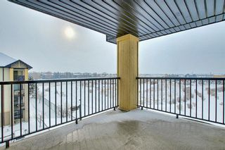 Photo 24: 7402 304 MacKenzie Way SW: Airdrie Apartment for sale : MLS®# A1081028