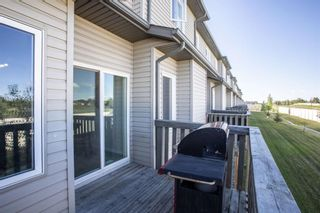 Photo 36: 407 620 Luxstone Landing SW: Airdrie Row/Townhouse for sale : MLS®# A1121530