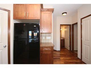 Photo 12: 103 WEST POINTE Court: Cochrane House for sale : MLS®# C4042878