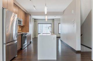 Photo 4: 1015 Evansridge Common NW in Calgary: Evanston Row/Townhouse for sale : MLS®# A1134849