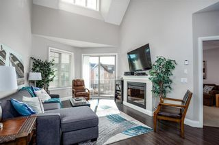 Photo 2: 2408 15 Sunset Square: Cochrane Apartment for sale : MLS®# A1123430
