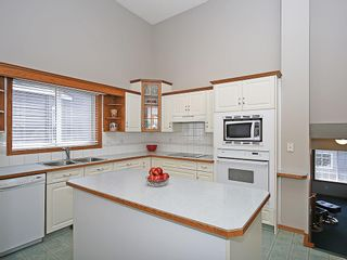 Photo 4: 1103 THORBURN Drive SE: Airdrie House for sale