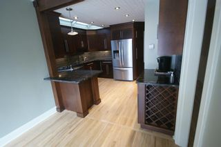 Photo 10: 3207 ALFEGE Street SW in Calgary: Upper Mount Royal Detached for sale : MLS®# A1055978