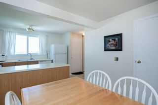 Photo 18: 332 Queenston Heights SE in Calgary: Queensland Row/Townhouse for sale : MLS®# A1114442