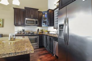 """Photo 7: 416 8328 207A Street in Langley: Willoughby Heights Condo for sale in """"Yorkson Creek"""" : MLS®# R2337768"""