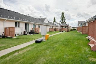 Photo 27: 9 209 Woodside Drive NW: Airdrie Row/Townhouse for sale : MLS®# A1106709
