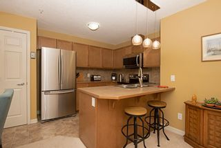 Photo 17: 1202 92 Crystal Shores Road: Okotoks Apartment for sale : MLS®# A1027921