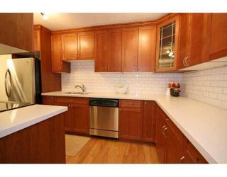 Photo 5: # 207 3921 CARRIGAN CT in Burnaby: Condo for sale : MLS®# V839201