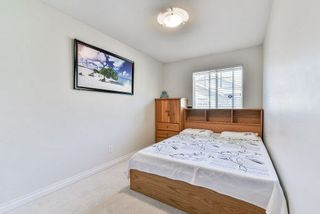 Photo 16: 102 9580 PRINCE CHARLES Boulevard in Surrey: Queen Mary Park Surrey Townhouse for sale : MLS®# R2295935