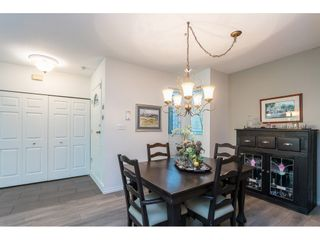 """Photo 11: 102 2733 ATLIN Place in Coquitlam: Coquitlam East Condo for sale in """"ATLIN COURT"""" : MLS®# R2475795"""