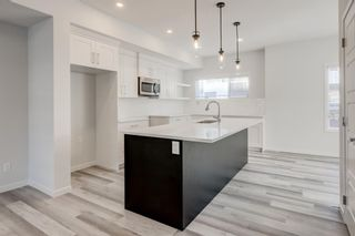 Photo 10: 268 Harvest Hills Way NE in Calgary: Harvest Hills Row/Townhouse for sale : MLS®# A1069741