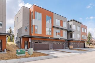 Photo 1: 145 Shawnee Common SW in Calgary: Shawnee Slopes Row/Townhouse for sale : MLS®# A1097036