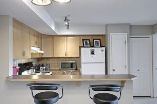 Photo 10: 204 300 Edwards Way NW: Airdrie Apartment for sale : MLS®# A1111430