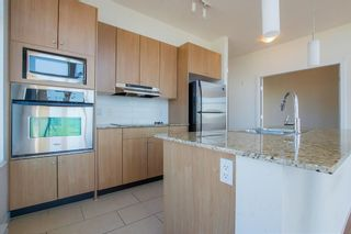 Photo 5: 418 15322 101 Avenue in Surrey: Guildford Condo for sale (North Surrey)  : MLS®# R2305760