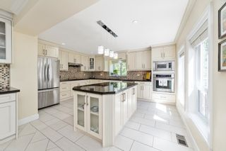 """Photo 18: 7464 149A Street in Surrey: East Newton House for sale in """"CHIMNEY HILLS"""" : MLS®# R2602309"""