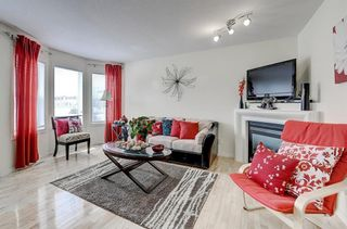 Photo 7: 3 EVERRIDGE Villa SW in Calgary: Evergreen Semi Detached for sale : MLS®# C4297700