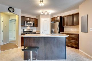 Photo 8: 104 20 Panatella Landing NW in Calgary: Panorama Hills Row/Townhouse for sale : MLS®# A1117783
