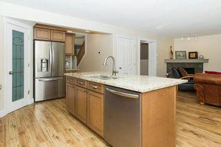 Photo 10: 67 CRYSTALRIDGE Close: Okotoks House for sale : MLS®# C4139446