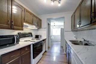 Photo 10: 104 210 86 Avenue SE in Calgary: Acadia Row/Townhouse for sale : MLS®# A1148130